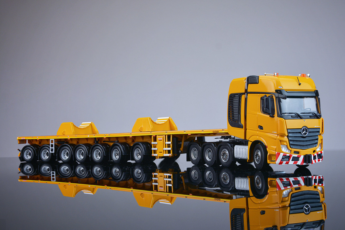 https://www.nooteboomshop.com/public/data/image/article/1002/975/large/yellow-series-7-axle-ballasttrailer-and-boom-saddles-mercedes-benz-actros2-gigaspace-8x4.jpg