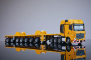 https://www.nooteboomshop.com/public/data/image/article/1002/975/small/yellow-series-7-axle-ballasttrailer-and-boom-saddles-mercedes-benz-actros2-gigaspace-8x4.jpg